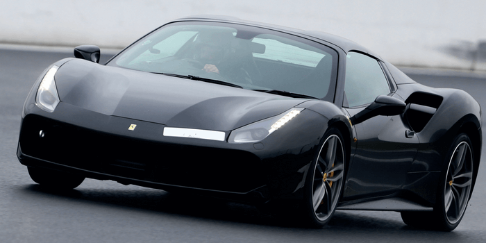 Black supercar on track
