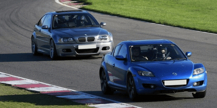 Two cars driving on a race track